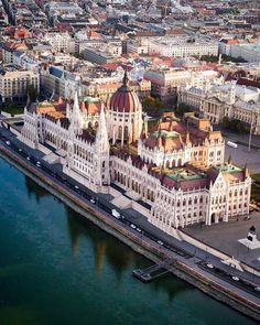 """A Buda-ful view over Budapest."" Want to see intricate architecture like this up close? Head to the link in our bio for a complete guide to Hungary's capital. Drone photo and sweet pun by Beautiful Places To Travel, Most Beautiful Cities, Wonderful Places, Wachau Valley, Budapest Travel Guide, Belle Villa, Travel Photography, Scenery, Places To Visit"