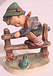 This is a cute little Hummel figure made by Goebel of a little boy climbing a fence. It is called Retreat to Safety and it stands 4 inches tall. It is marked 201 2-0 and has the TMK3 mark. There is no