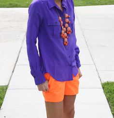 Chic sunner style-bright blue shirt and neon orange shorts with orange and coral statement necklace.