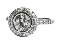 Halo Diamond Ring, 0.90 ct. Surrounded with 56 Diamonds in 18K White Gold  Setting  Metal type: 18K White Gold  Approx. gold weight: 3.47 gram  Setting type: Pave setting, Bezel setting   Main Stone  Stone type: 100% Natural Diamond  Shape: Round Brilliant cut  Minimum Weight: 1 stone / 0.90 ct.  Color grade: G-H  Clarity grade: SI2  Cut: Excellent  Treatment: Clarity Enhanced   Side Stones  Stone type: 100% Natural Diamonds  Shape Round-cut  Minimum Weight: 0.28 ct. tw. / 56 stone...