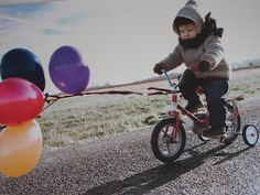 Add balloons to a tricycle or bike. Why not?!