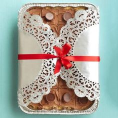 Foil pan fix-up Bake brownies or bars in a foil pan, cool, wrap with clear plastic wrap, and fold shiny silver doilies around the pan. Tie with a pretty Christmas ribbon. This gift gets even easier to make when you use a brownie mix. See the link below for some fantastic ways to turn that ordinary mix into a gift-worthy goodie! Related Links 12 ways to dress up brownie mix