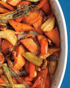 Honey-Roasted Vegetables. 375 degrees. toss 1/2 in pieces of 2 sweet potatoes, 4 carrots, 2 parsnips, 1/2 c walnuts, 1/4 c honey, and 2 Tbsp olive oil; season with salt and pepper. Top with thyme sprigs. roast until vegetables are browned at edges and tender, about 1 hour.