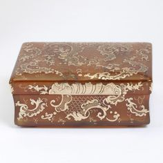 Box in case  Possibly Italy, about 1750  Horn decorated in gold piqué; leather case with stamped gilded decoration, lined with velvet