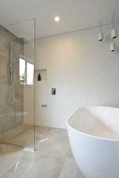 Emma & Courtney Main Bathroom from The Block NZ featuring Cementia Grey 600 x 600 and Honeycombe Internal White 48 x 61mm from Tile Space.
