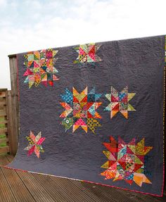 Superstar quilt, love the gray background with the bright colors.