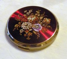 Vintage Compact Stratton Red Floral Mirror Purse Compact. $38.00, via Etsy.
