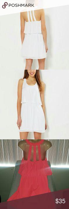 NWT Caged Back Dress Dress is brand new with tag like a pinkish orange color sz  medium Dresses Mini