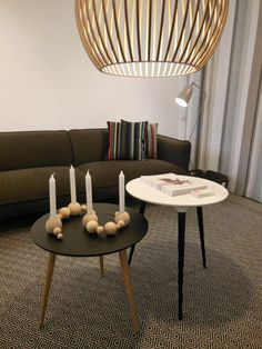 Octo pendant by Seppo Koho from Secto Design, Icicle tables by Thomas Pedersen from Fredericia, Grasshopper floor lamp by Greta Magnusson Grossman from Gubi and Continental sofa by Claesson Koivisto Rune from Swedese