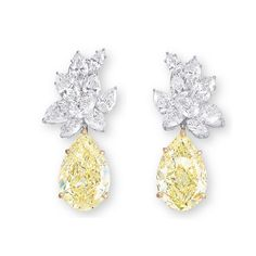 A PAIR OF DIAMOND EAR PENDANTS  EACH PEAR AND MARQUISE-CUT DIAMOND CLUSTER, SUSPENDING A PEAR-SHAPED DIAMOND WEIGHING APPROXIMATELY 8.83 AND 8.16 CARATS, MOUNTED IN 18K WHITE AND YELLOW GOLD, 3.7 CM LONG.