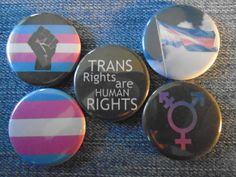 "Trans Pride 1.25"" back buttons. Set of 5 different badges.Transgender pride, trans pride flag, trans pride symbol, radical fist, fight back"