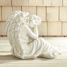 There really are angels among us. Handcrafted of stone with an antiqued finish, our Pondering Angel deserves a prominent place in your garden. Intricate details in the design give this great wonderer a realistic yet ethereal look.