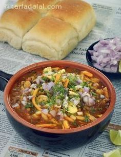 One of the most famous of Maharashtrian recipes, Misal is a scrumptious cocktail of savouries and sprouts! Wholesome and tasty sprouts are cooked with tangy tomatoes and pungent onions, not to forget (Tasty Vegetable Recipes) Vegetable Recipes, Vegetarian Recipes, Cooking Recipes, Indian Snacks, Indian Food Recipes, Misal Pav Recipes, Bhaji Recipes, Maharashtrian Recipes, Breakfast Recipes
