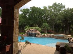This waterfall adds soothing ambiance to the backyard year-round and adds a fun element to the pool in the Summer.