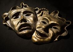 Theatrical masks of a greek tragedy.