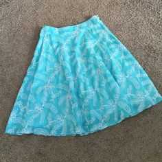 Pretty Milly skirt Sky blue with beautiful embroideries! So feminine and pretty.  In excellent condition.  Side zipper with 2 button finish.  Please enjoy;) Milly Skirts Midi