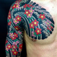 Clean and vibrant sakura (blossoms) chest to half sleeve tattoo by Horihide. horihide sakura chest halfsleeve blossoms japanesestyle