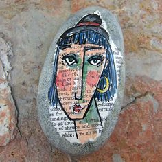 Painted Face- on a rock!  I would like to have a few of these.
