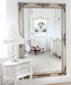 Love the french furniture and the gold mirror within the white decor. Antique french decor makes my heart melt. I have a few pieces in our bedroom.