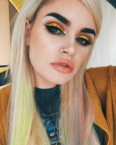 yellow and orange eye make up. 60s inspired eye make up.