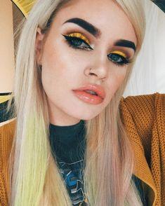 yellow and orange eye make up. 60s inspired eye make up.