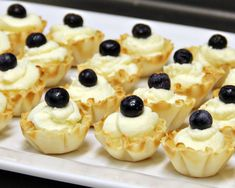 white chocolate mousse in phyllo cups a quick and easy dessert #BestMini #dessertImagesGallery Finger Desserts, Bite Size Desserts, Mini Desserts, Easy Desserts, Delicious Desserts, Dessert Recipes, Yummy Food, Cold Desserts, Wedding Desserts