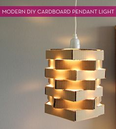 Diy cardboard light....I personally would not leave it this ...cardboardish... I would cover it with something, otherwise a great idea