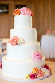 Summer wedding cake idea - four-tier, white frosted wedding cake with pink + orange flowers {Hearts & Horseshoes Photography}