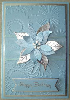 Hand made birthday card using flower frenzy embossing folder and poinsettia die.
