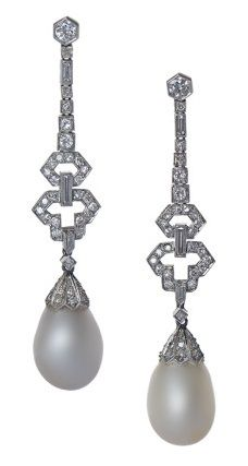 A PAIR OF VERY FINE NATURAL PEARL EARRINGS. by CUSI (Italian), CIRCA 1920. Two impressive pear-shaped natural pearls, 13cts and 14cts approx, are each suspended by attractive Art Deco diamond and platinum mounts.