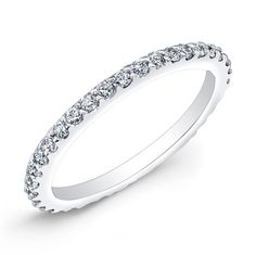 This 14KT white gold wedding band features 31 prong-set round diamonds.