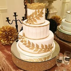 LaShaias' Grecian themed wedding cake... Accented in gold sugar braches, topped with a gold leaf crown.  #cakesbylameeka #customcakes #southernweddings #grecian