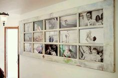 Old door repurposed as photo frame...Want this for the hallway