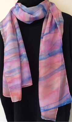 Large long silk scarf hand painted with a stripe design in shades of blue, purple and pink