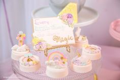 """Everything she does..."" cookie + chocolate covered Oreos from a Baby Unicorn 1st Birthday Party on Kara's Party Ideas 