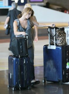 """at the Charles de Gaulle Airport in Paris France on Sept. 4 2010 - Ashley Greene (of """"Twilight"""") with a Rimowa Salsa Multiwheel Trolley. Find yours: http://www.irvsluggage.com/Rimowa-Luggage"""