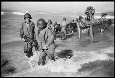 US Rangers offloading onto Licata Beach, Sicily. Invasion Day, July 10, 1943. Read more: Phil Stern: Classic World War II Photos, Italy, 1943   LIFE.com