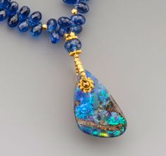 Australian boulder opal on faceted kyanite drops and 18K gold