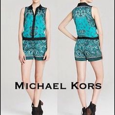 Michael Kors Women's Green Polyester Romper This green romper by authentic brand Michael Kors is in style right now. All photos of the item were taken in-house to give you the most detail possible. It's an adult women's size L Regularmade from 100% polyester. SGI Fashion took the full set of tailor's measurements on this item to ensure it fits perfectly. Pant Waist: 17 Michael Kors Shorts