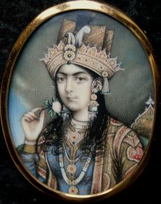 """Posthumous portrait of Nurjahan, wife of Mughal Emperor Jahangir (1570 - 1627). Anglo-Indian (or """"Company School"""") tradition at Delhi, circa 1840. Gouache and gold on ivory in 20th century frame (retains original domed glass). 6.3 x 5cm."""