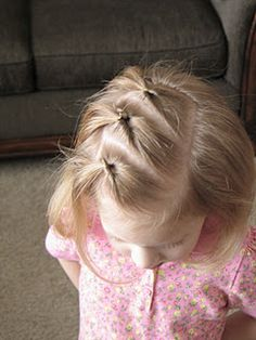 Yet another simple, great idea for keeping hair out of Esther's eyes while we grow her bangs out. Luckily, she is very patient while I do her hair. I'll have to try this on Hannah as well...