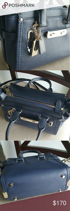 "Coach Swagger (small) Brand new (without tags), navy pebbled leather. Gold accents.  Comes with dust bag.  Authentic.  Measures 9""x6"".  At its widest, 4"".  Can be worn as crossbody! Coach Bags"