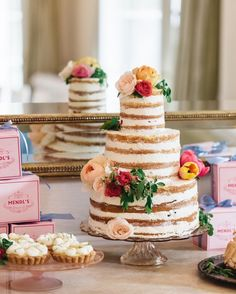 This triple berry cake created bySweet Lady Jane was the stand-out piece of the dessert table at Jenny Bernheim of Margo & Me's super-chic bridal shower.Key lime tartlets and meringues surrounded the unfrosted confection.