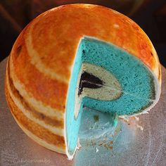 Space party birthday cake that looks like the planet Jupiter.
