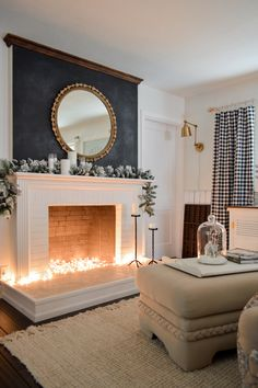 Holiday Housewalk Cottage Christmas Home Tour. Simple holiday home decorating. Neutral home peppered with greenery, black and white buffalo check, candles and lots of cozy! - Holiday Housewalk Cottage Christmas Home Tour Fake Fireplace, Fireplace Mantle, Living Room With Fireplace, Fireplace Ideas, Fake Mantle, Fireplace Lighting, Decorative Fireplace, Candles In Fireplace, Black Fireplace