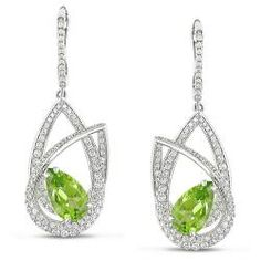@Overstock - Lush green pear-cut peridot gemstones adorn each of these stunning earrings, accentuated by the icy white sparkle of diamonds. The earrings are crafted of 14-karat white gold and include leverback clasps.http://www.overstock.com/Jewelry-Watches/Miadora-14k-White-Gold-Peridot-and-1-2-5ct-TDW-Diamond-Earrings-G-H-SI1-SI2/5828759/product.html?CID=214117 $3,902.39