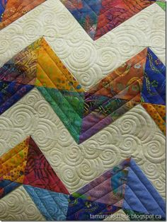 Chevron Baby Quilt by Tamarack Shack - interesting quilting in the negative space, looks like it was fun to do!