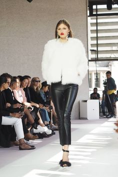 London Fashion Week Topshop Unique Show Spring Summer 2016 with leather trousers and white fluffy jackets
