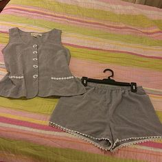 "Victoria's secret country quality cotton short set Victoria's secret country quality cotton black and white gingham checked loungewear shorts and top set.  Top has daisy buttons and drawstring in back.  Shorts have elastic waist.  Size small,  Armpit to armpit is 18"".  Waist is 15"" laid flat.  Fabric has some pilling which can be felt but not seen, otherwise no flaws.  Super cute and light weight summer loungewear. Victoria's Secret Intimates & Sleepwear"