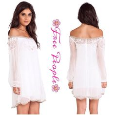 Stunning Embellished Free People Dress/Tunic This dress is so gorgeous in 100% Viscose, so soft and flowy, off the shoulder style embellished with beading and shirted ruffle trim, back button closure, bohemian luxury...Can be worn as a tunic or dress.. Free People Dresses Mini